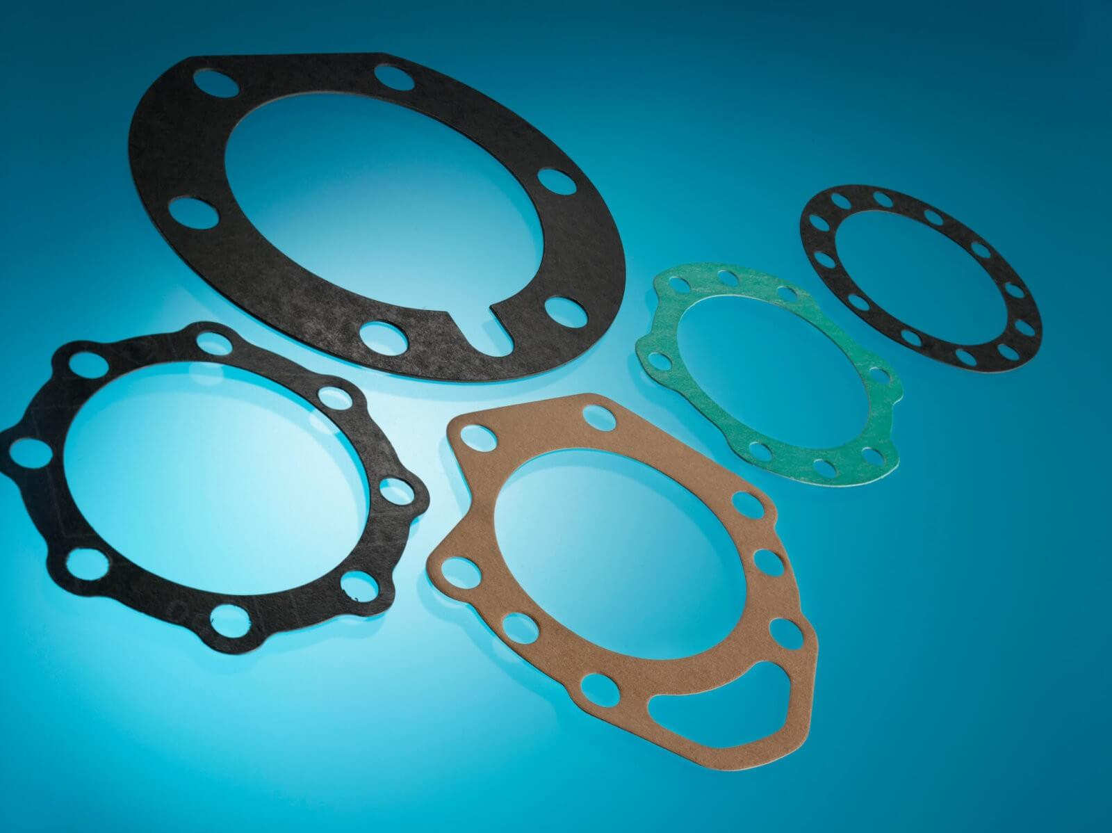 Automotive Parts Gasket. Gaskets made in Metal, Cellulose Pape, Composite, Shim Steel materials.